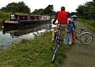 Family Riding along Canal